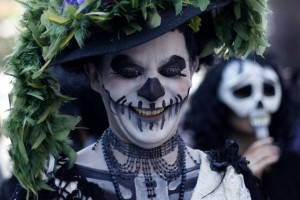 A participant in costume takes part in a performance ahead of Halloween celebrations in Santiago