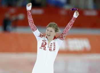 Olga Fatkulina of Russia celebrates after competing in race two of the women's 500 meters speed skating event during the 2014 Sochi Winter Olympics