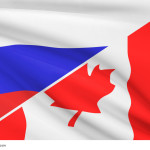 Flags of Russia and Canada blowing in the wind. Part of a series.