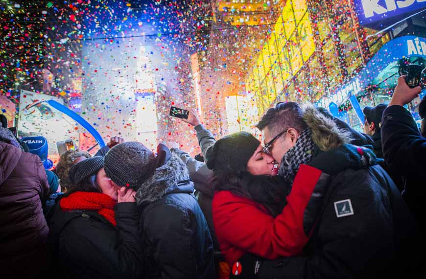 NEW YORK, NY - JANUARY 01:  Couples kiss after midnight in Times Square during the New Years Eve celebration on January 1, 2013 in New York City. An estimated one million revelers from around the world endured long hours of cold weather to have a front seat to this year's star studded celebration. (Photo by Christopher Gregory/Getty Images)